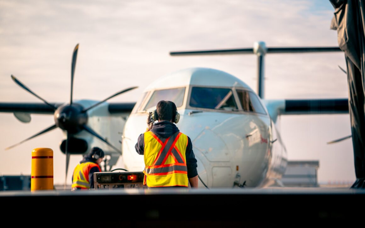man-standing-in-front-of-airplane-3459336
